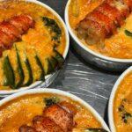 Gratin de homard préparé par l'Atelier des Gourmands